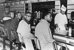 Four Students Sitting at Lunch Counter