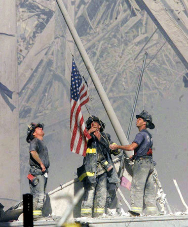 Firemen wih American Flag at Ground Zero