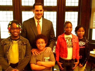 Rich Negrin standing with Students